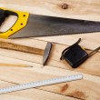Carpenter's tools on pine desks — Stock Photo