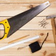 Carpenter's tools on pine desks — Stock Photo #11650624