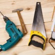 Carpenter's tools on pine desks — Stock Photo #11650649