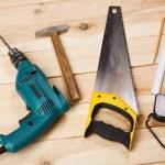 Carpenter's tools on pine desks — Stock Photo