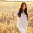Beautiful lady in wheat field — Stock Photo #11650657