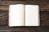 Aged book on wooden table — Stock Photo