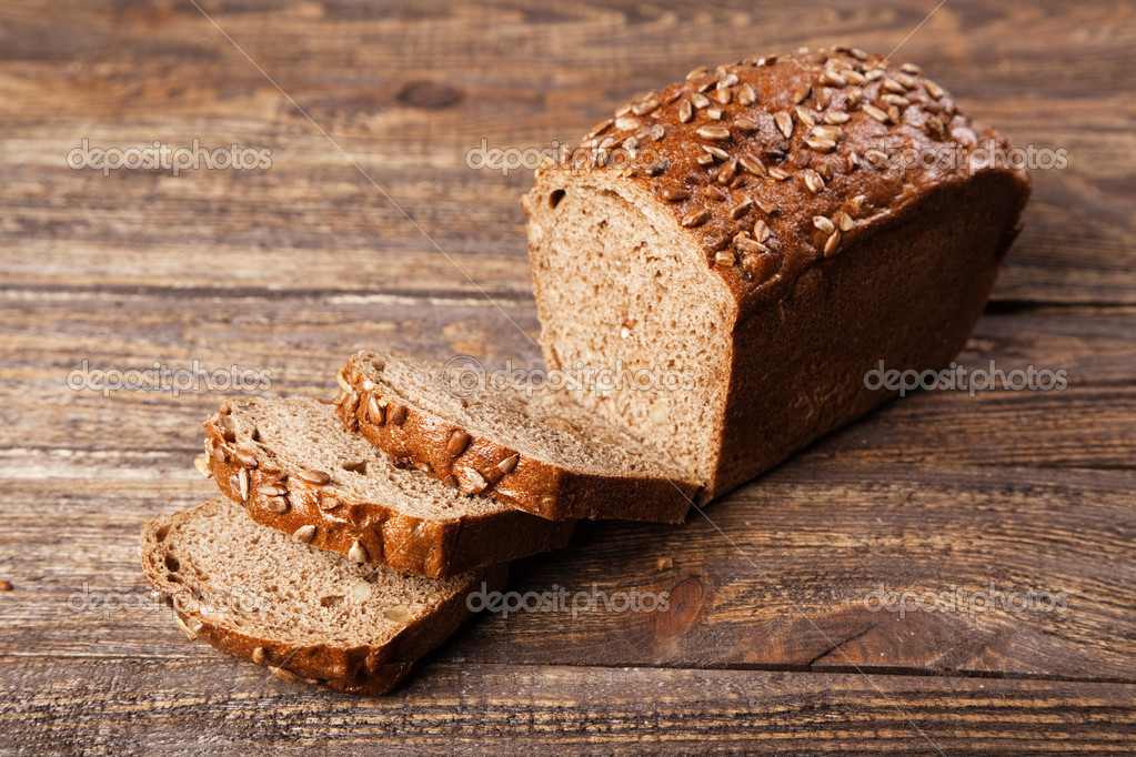 Brown bread on an old wooden table — Stock Photo #11835968
