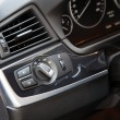 Lights switch in a luxury car - Stock Photo