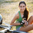 Beautiful young woman riding a bicycle — Stock Photo