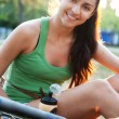Beautiful young woman riding a bicycle — Stock Photo #12196391