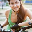 Beautiful young woman riding a bicycle — Stock Photo #12196393