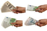 Dollar, euro and rouble bills in a hand — Stock Photo