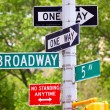 Broadway, 5th avenue and One Way Street Signs - Stock Photo