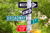 Broadway, 5th avenue and One Way Street Signs — Stock Photo