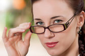 The girl wearing spectacles — Stock Photo
