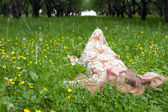 The woman in park on a grass — Stock Photo