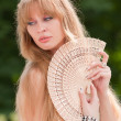 The girl and a fan - Stock Photo