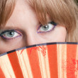 Eyes and a fan — Stock Photo