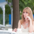 Stock Photo: The woman drinks coffee