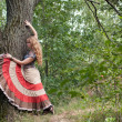 The woman of hippie and a tree — Stock Photo