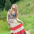 The woman of hippie in a skirt — Stock Photo