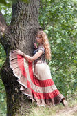 The girl of hippie and a tree — Stock Photo