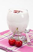 Yogurt with sweet cherry — Stock Photo