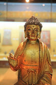 Statue of a gold Buddha — Stock Photo
