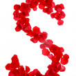 Rose petals forming letter — Stock Photo