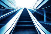 Moving up escalator — Foto Stock