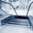 Stock Photo: Moving up escalator