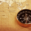 Compass on a Treasure map - Stock Photo