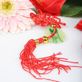 Red embroidery Sachet and Pink Chrysanthemum — Stock Photo