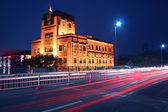 The light trails on the modern building — Stock Photo