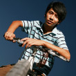 Young asian biker — Stock fotografie