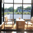 Table and chairs by window — Stock Photo #10787217