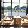 Stockfoto: Table and chairs by window