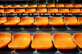 Bright yellow stadium seats — Stock Photo