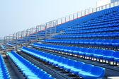 Bright red stadium seats — Stock Photo