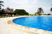 Swimming pool in china hotel with palm trees. china,Sanya — Zdjęcie stockowe
