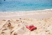 Red hat in the beach — Stock Photo