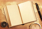 Old book on a Treasure map — Stock Photo