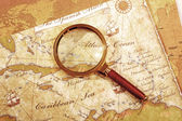 An Magnifier on a Treasure map — Stock Photo