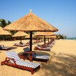 Sunshade and chairs on beach, Sanya, China — Stock Photo