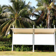 Stock Photo: Bus stations near tropical trees