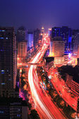 Traffic on night road junction — Stockfoto