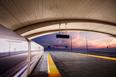 Train stop at railway station with sunset — Stock Photo