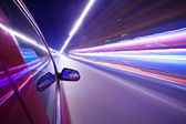 Night traffic,shoot from the window of rush car,motion blur stee — Stock Photo