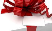 Christmas white gift box red ribbon — Stock Photo
