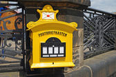 Yellow letterbox — Stock fotografie