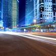 Light trails on the modern city street at night — Stock Photo