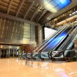 Modern escalators in hall - Stock Photo