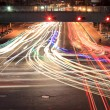 Light traces on crossroad at night — Stock Photo