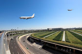 Flight arrival in airport — Stock Photo